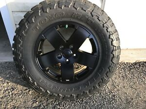 "275/70/18(33.6"") Toyo open country M/T's on Jeep rims"