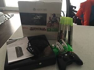 Xbox 360 with 2 controllers, headset and 6 games