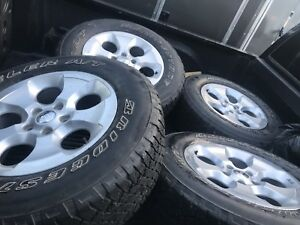 4 tires on Jeep rims. 255/70/18