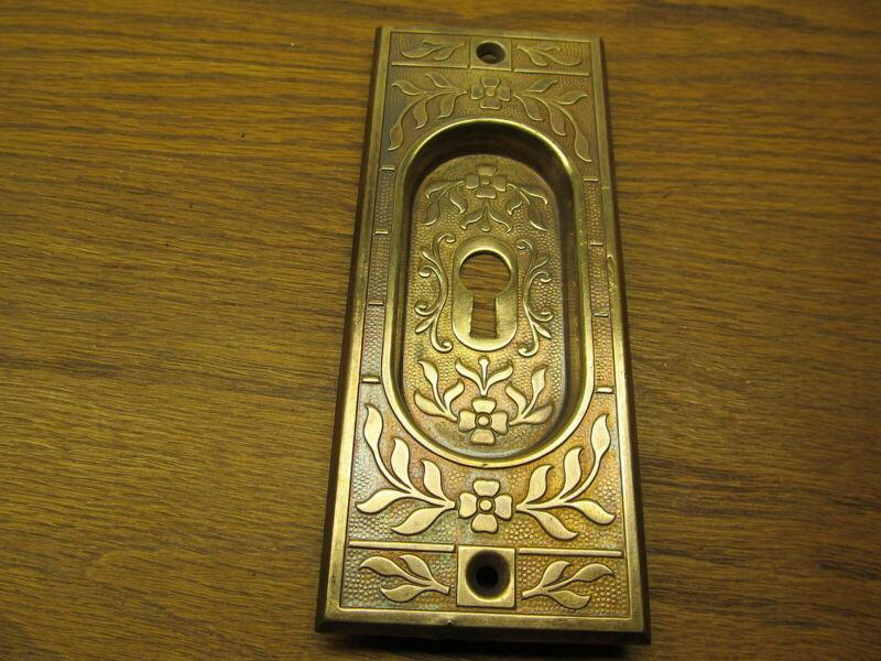 BRASS STAMPED POCKET DOOR ESCUTCHEON...ORNATE...