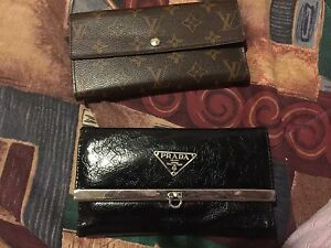Prada and Louis Vuitton wallets