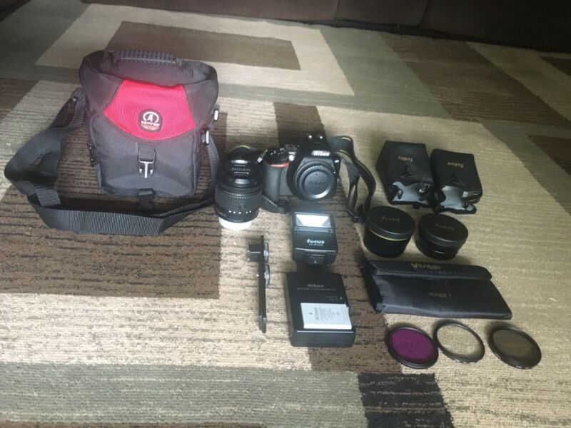 Nikon D3500 with 18-55 mm lens and extras!!