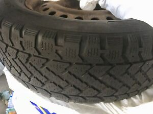 4 16 inch snow tires mounted on rims