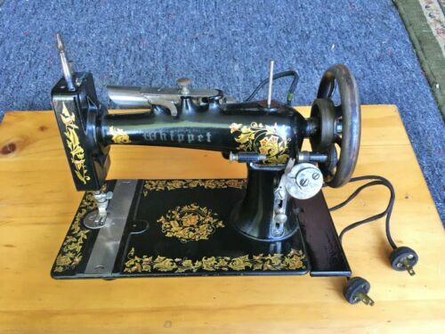 Whippet Ornate Electric Sewing Machine with Manuals and Attachments