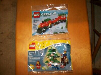 Christmas lego sets ages 6 and up. lot of 2 unused train & Christmas tree.