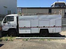 Reduced Ford Trader truck with service body Coopers Plains Brisbane South West Preview
