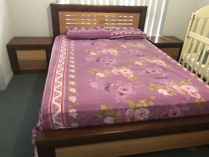 Wooden queen size bed with bedside tables