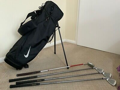 Nike Junior Golf Bag & Few Clubs Including Two Putters(see Other Photos)