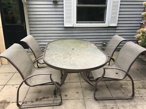 Glass table patio set
