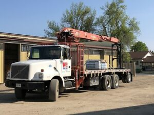 Volvo drywall boom truck with aluminum flat deck