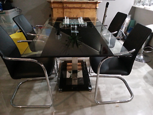 Black glass Dining table and chairs Bayview Darwin City Preview