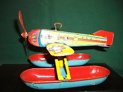 vtg tin toy chein airplane toy float plane old wind up works.