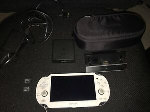 White PS Vita OLED + battery pack + 4gb card + 32gb card