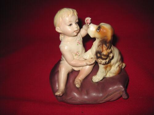 Vintage porcelain piano baby & Cocker Spaniel dog figurine