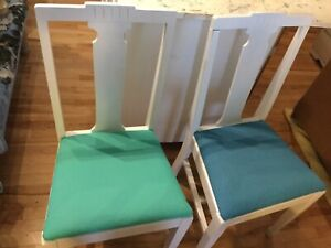 Assorted chairs with fabric seats