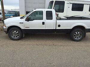 2003 Ford F-250 6.0 L extended cab long box.