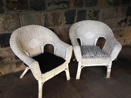 White cane arm chairs