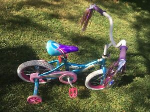 """Girls bike with 14"""" wheels,training wheels, excellent condition"""