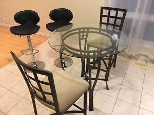 Counter height table with chairs and stools