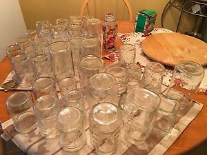 50 Canning jars with lids in a variety of sizes.