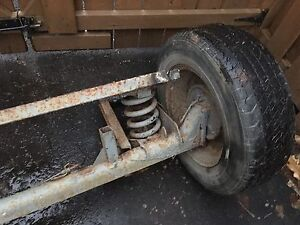 Utility trailer axle with suspension