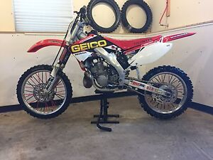 2 bikes-2003 cr250 and 2012 crf250r with papers