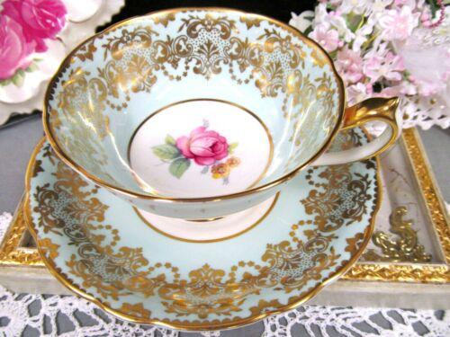 Paragon tea cup and saucer baby blue pink rose center gold gilt teacup England