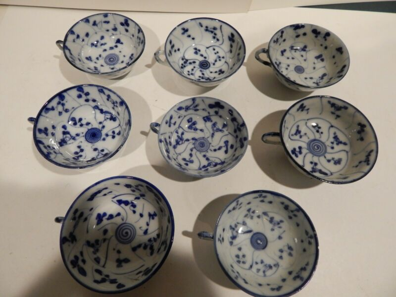 Antique blue and white hand painted porcelain tea cups and saucers