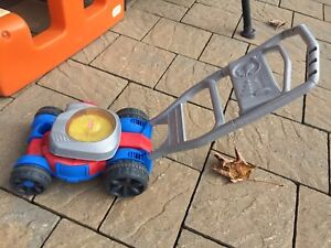 Used fisher price toddler toy lawn mover