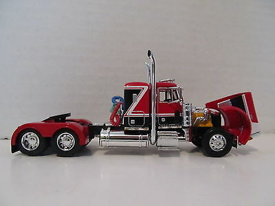 DCP 1/64 SCALE 379 PETERBILT (DAY CAB OPT) RED/BLACK WITH WHITE STRIPE  1