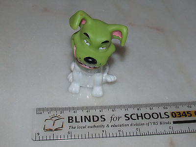 NEW LINE TV INC 1999 COLLECTABLE SMILING PLASTIC DOG WITH GREEN HEAD WHITE BODY