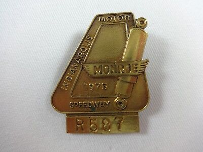 1975 Indy 500 Bronze/Gold Tone Pit Badge Bobby Unser Gurney's All American Racer Indy 500 Racers