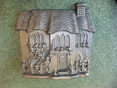 ANTIQUE   CAST IRON DOORSTOPPER IN THE FORM OF A COTTAGE