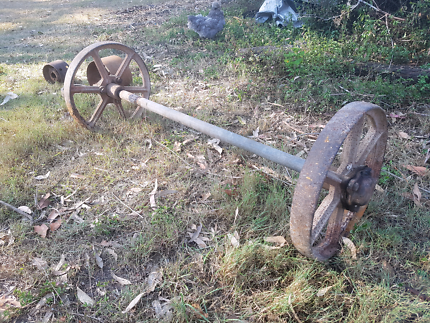 Antique cast iron wheels on an axel