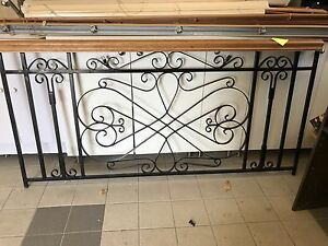Section of rot iron railing with cherry wood hand rail
