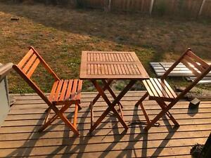 wooden deck chairs and table