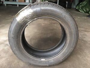 One 185-60-15 tire