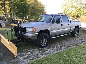 2002 GMC Sierra 2500 with fisher plow need gone