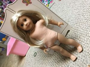 Gently used American girl doll clothes,doll and dresser