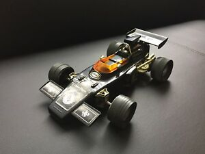 Vintage F1 Lotus 72E JPS AM radio toy car.