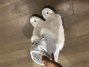 White Mukluks, real leather and real fur.