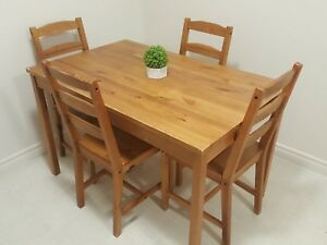 Dining table with 4 chairs, good condition.