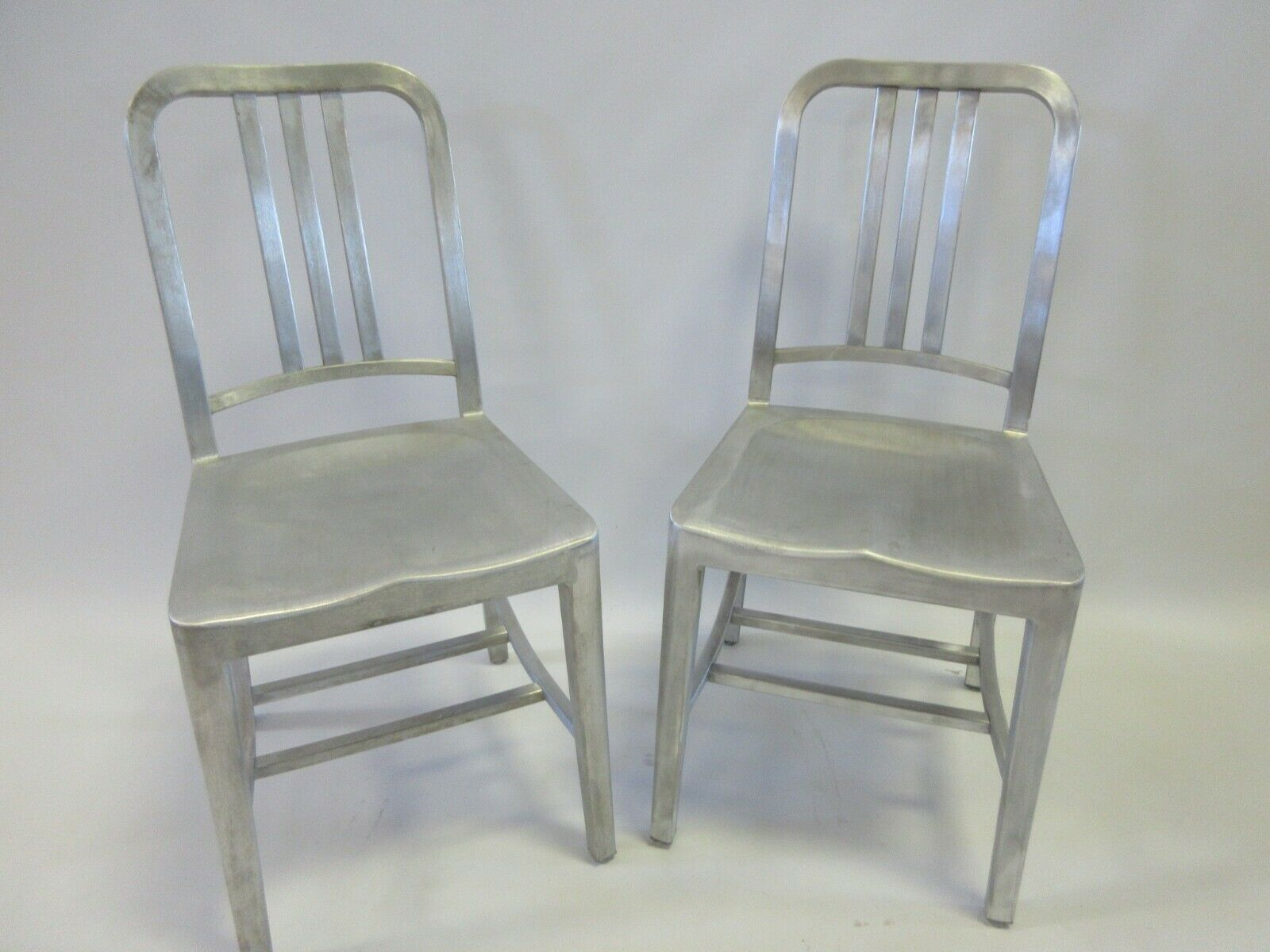 Photo Two (2) Genuine EMECO 1006 Navy Chairs in Brushed Aluminum