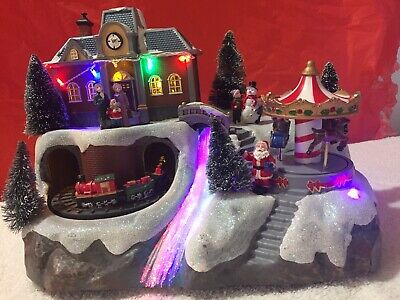 Fiber Optic & led Village plays Christmas music with train, carousel & waterfall