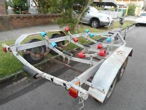 CHEAP LARGE GOOD COND BOAT TRAILER TWIN AXLE FOR UP TO 18 FT.