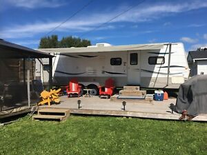 Trailer in park for sale.