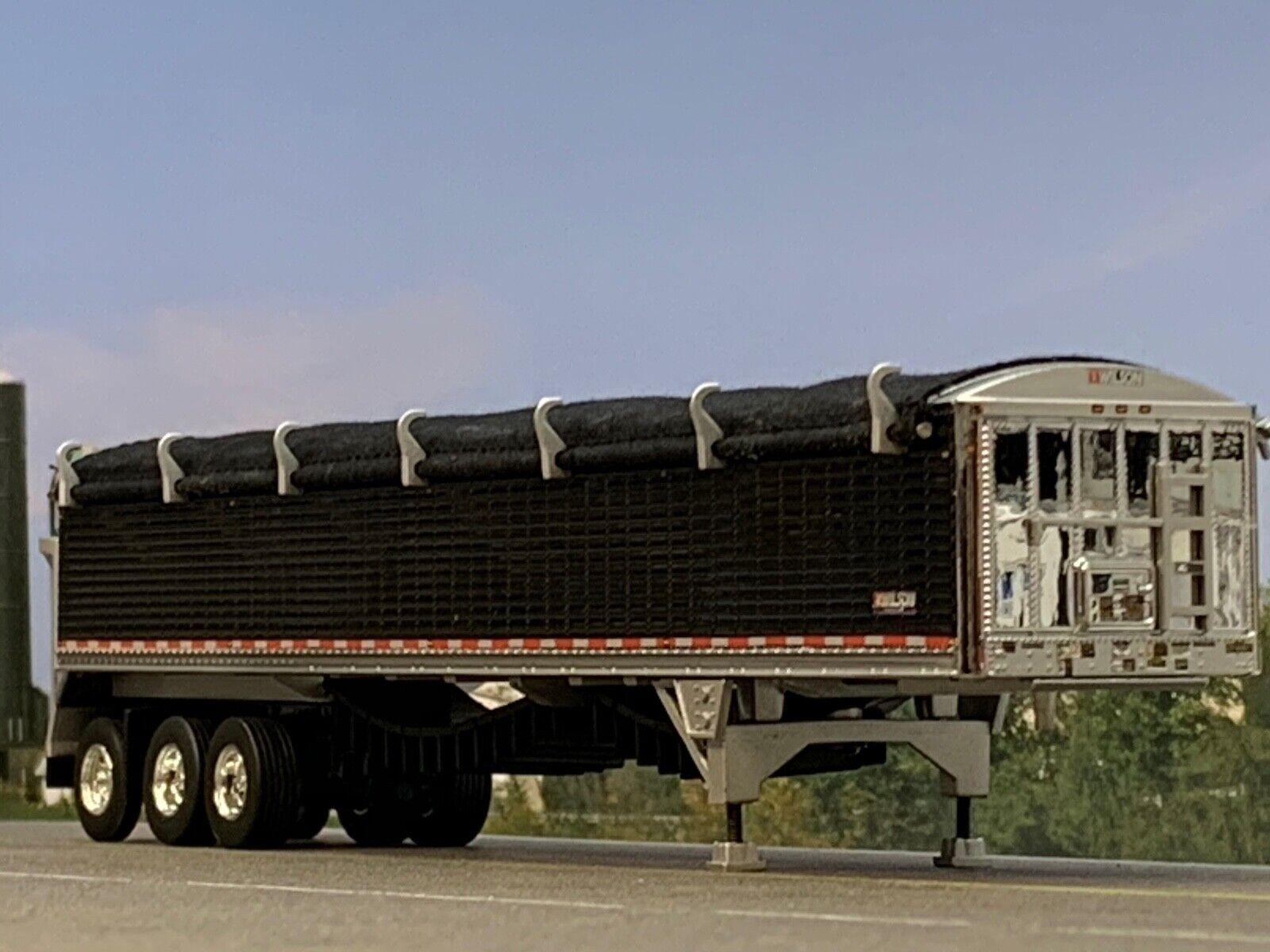 1/64 DCP BLACK WILSON PATRIOT TRI-AXLE (SUPER SINGLES) BELT TRAILER W/ BLK TARP
