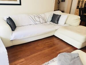 White Leather Sectional + Blanket/Pillows for Seating Area