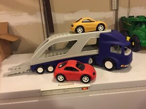 Large little tikes truck with two cars