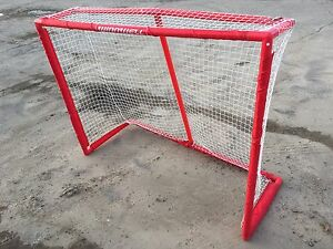Road hockey net with plastic frame.